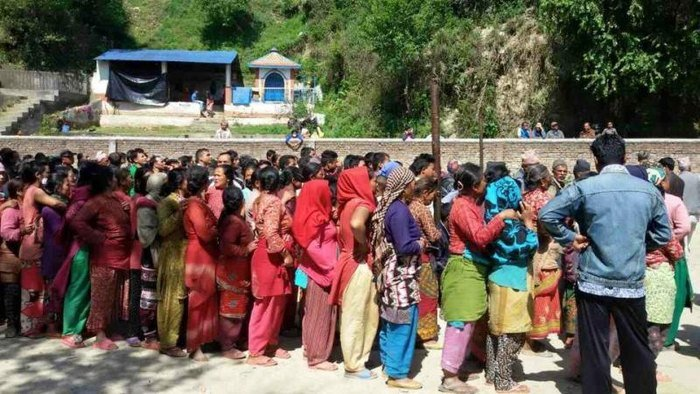 Nepalis in line for food, water, and shelter materials